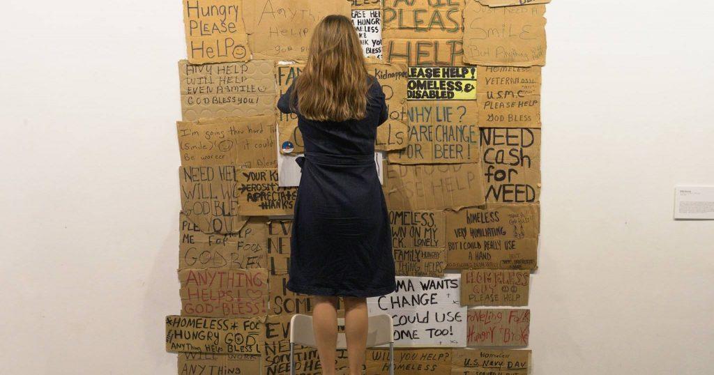 Image may contain: Carton, Dress, Box, City, Building, Urban, Town, Metropolis, Skirt, Cardboard, Human, Person, Clothing, Apparel