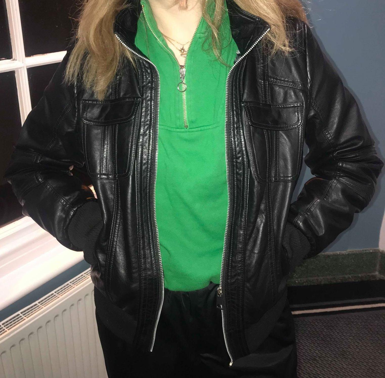 Image may contain: Sleeve, Long Sleeve, Leather Jacket, Jacket, Coat, Clothing, Apparel