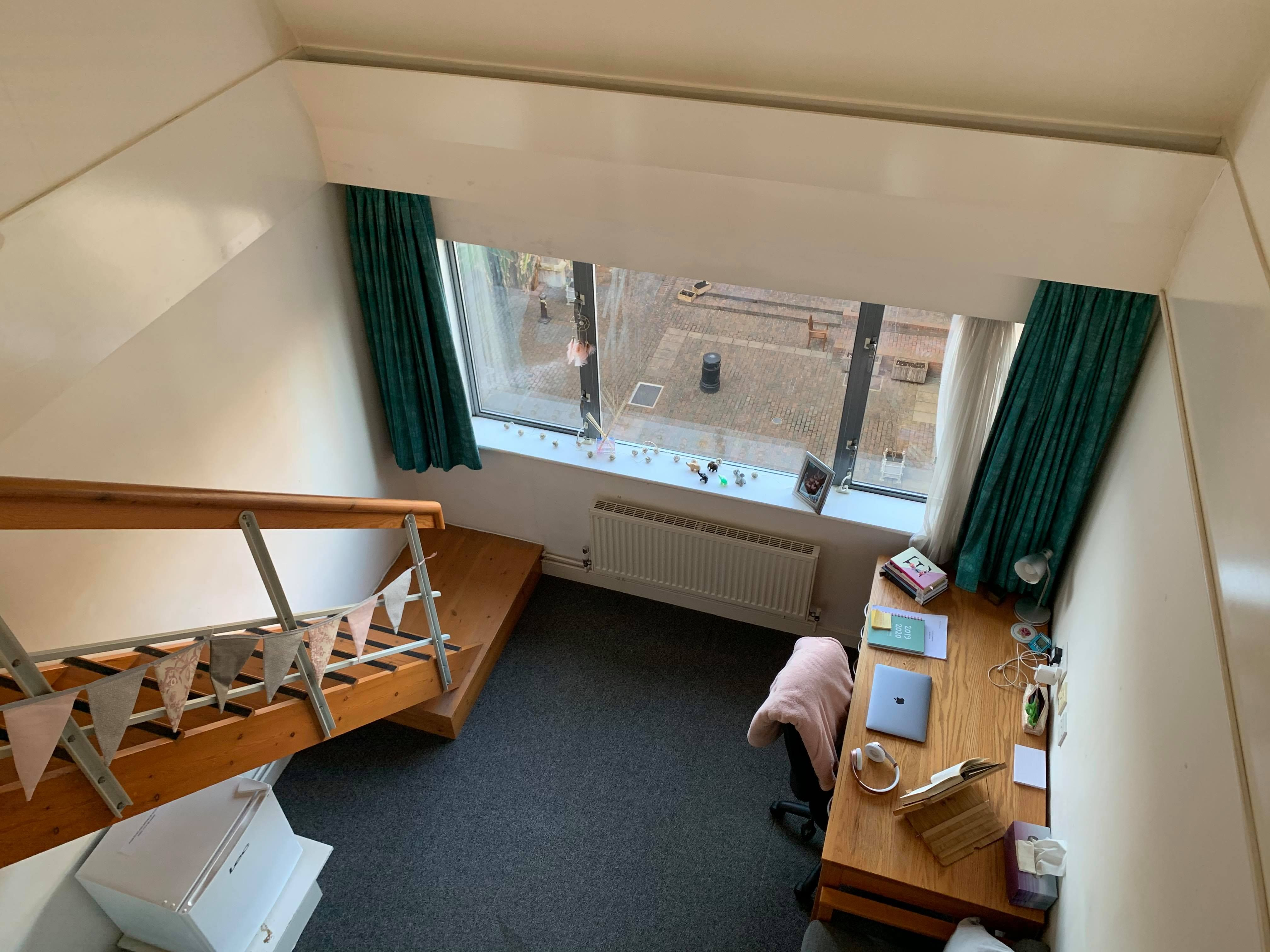 Image may contain: Hostel, Dorm Room, Plywood, Floor, Hardwood, Living Room, Indoors, Bedroom, Room, Flooring, Wood, Housing, Building