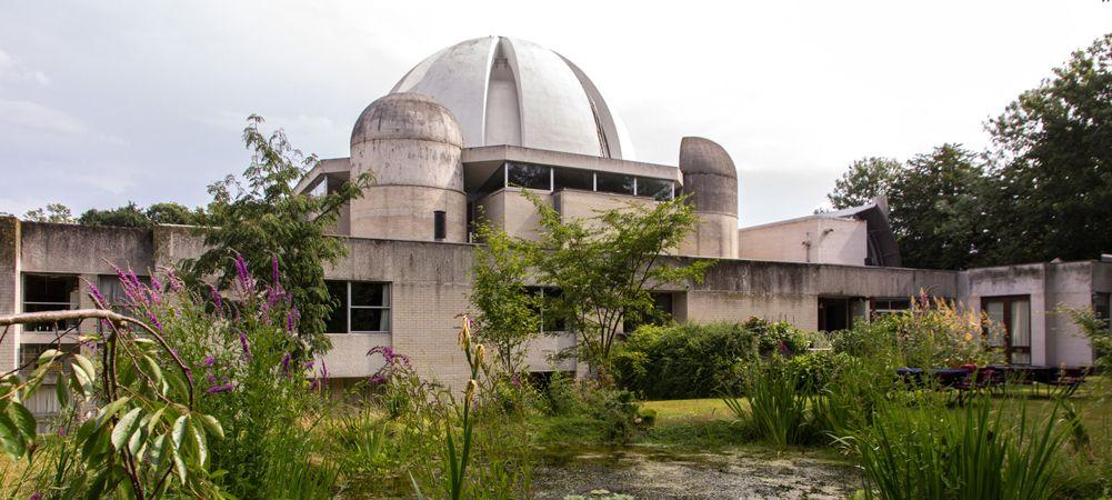 Image may contain: Housing, Observatory, Dome, Vegetation, Plant, Bush, Planetarium, Architecture, Building
