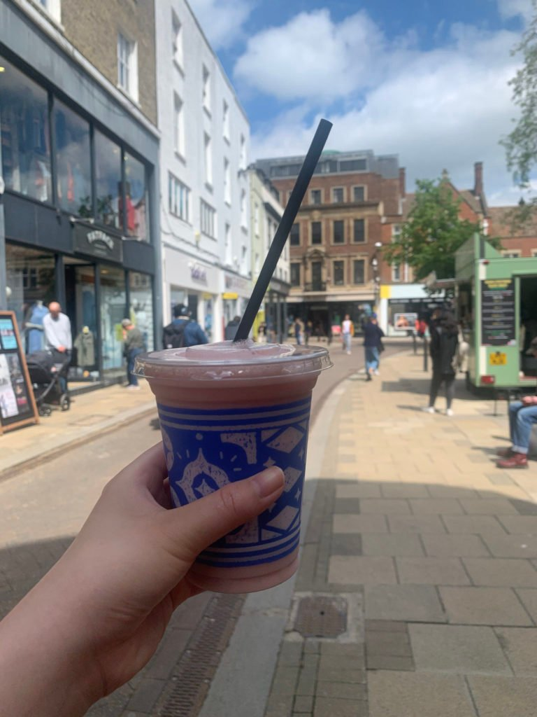 Hand holding a Caffè Nero fruit booster