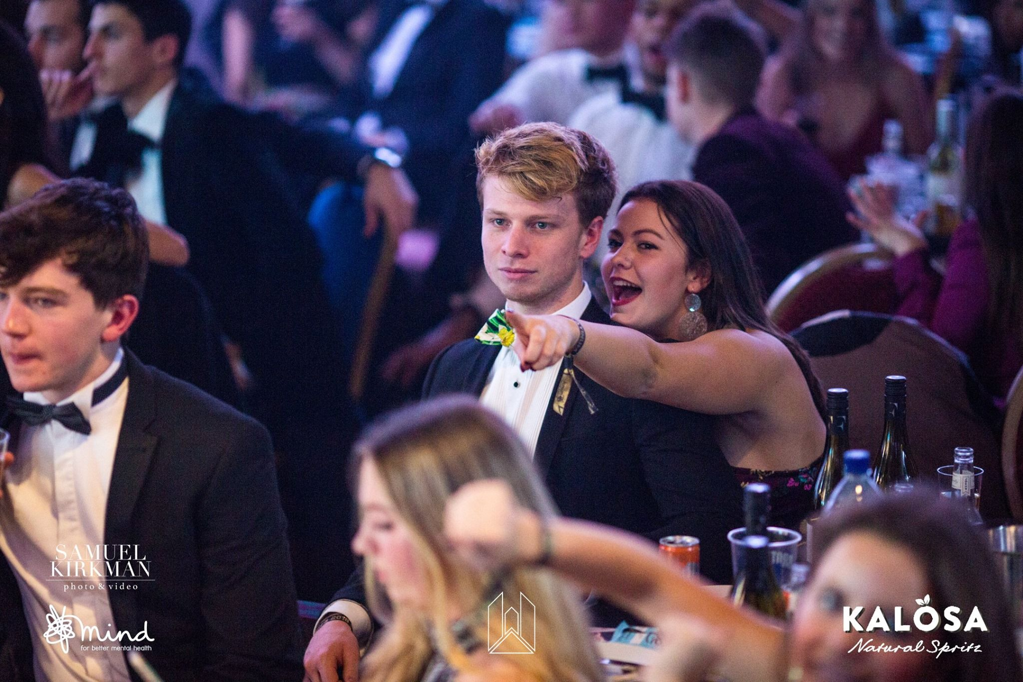 Image may contain: Night Life, Party, Night Club, Coat, Suit, Overcoat, Clothing, Apparel, Club, Bar Counter, Audience, Crowd, Pub, Person, Human