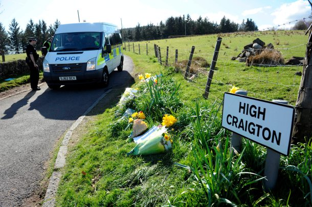 Floral tributes at High Craighton Farm near Bearsden, outside Glasgow, April 16, 2015, where body parts said to be from Karen Buckley, 24, were found