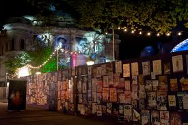 The Hadrian's wall of flyers in Bristo Square.