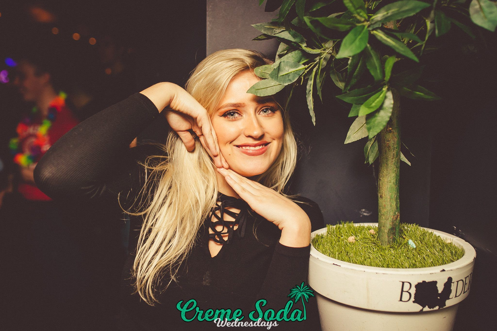 Image may contain: Light, Laser, Dill, Tree, Potted Plant, Plant, Bonsai, Woman, Female, Blonde, Human, Person, People