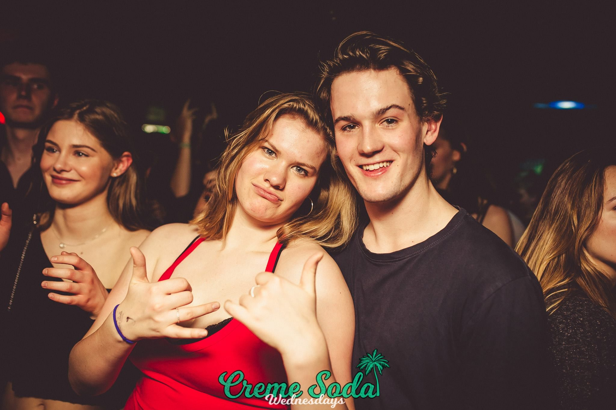 Image may contain: Night Life, Night Club, Club, Smile, Portrait, Face, Person, People, Human