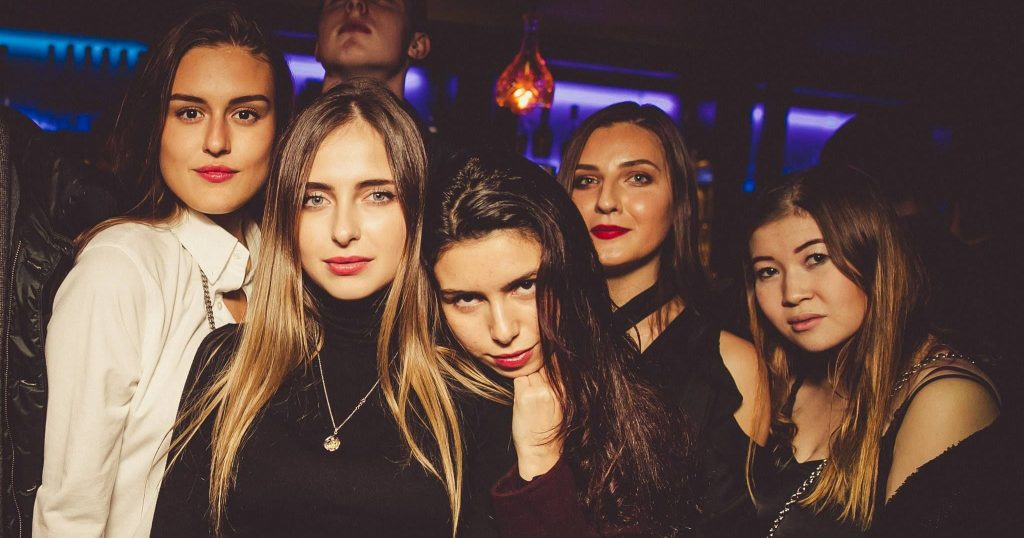 Image may contain: Haircut, Hair, Night Life, Night Club, Club, Person, People, Human