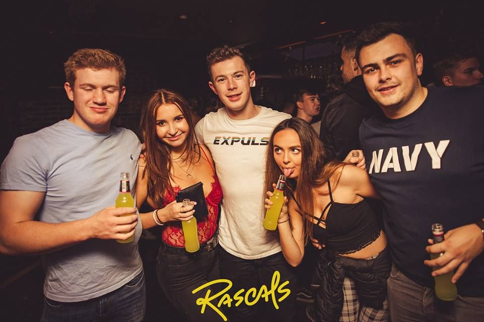 Image may contain: Beer, Alcohol, Bottle, Beverage, Drink, Night Club, Club, Party, Human, Person