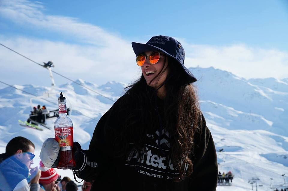 Image may contain: Bottle, Snow, Coke, Coca, Ice, Mountain Range, Peak, Beverage, Drink, Mountain, Hat, Clothing, Apparel, Outdoors, Sunglasses, Accessories, Accessory, Nature, Human, Person