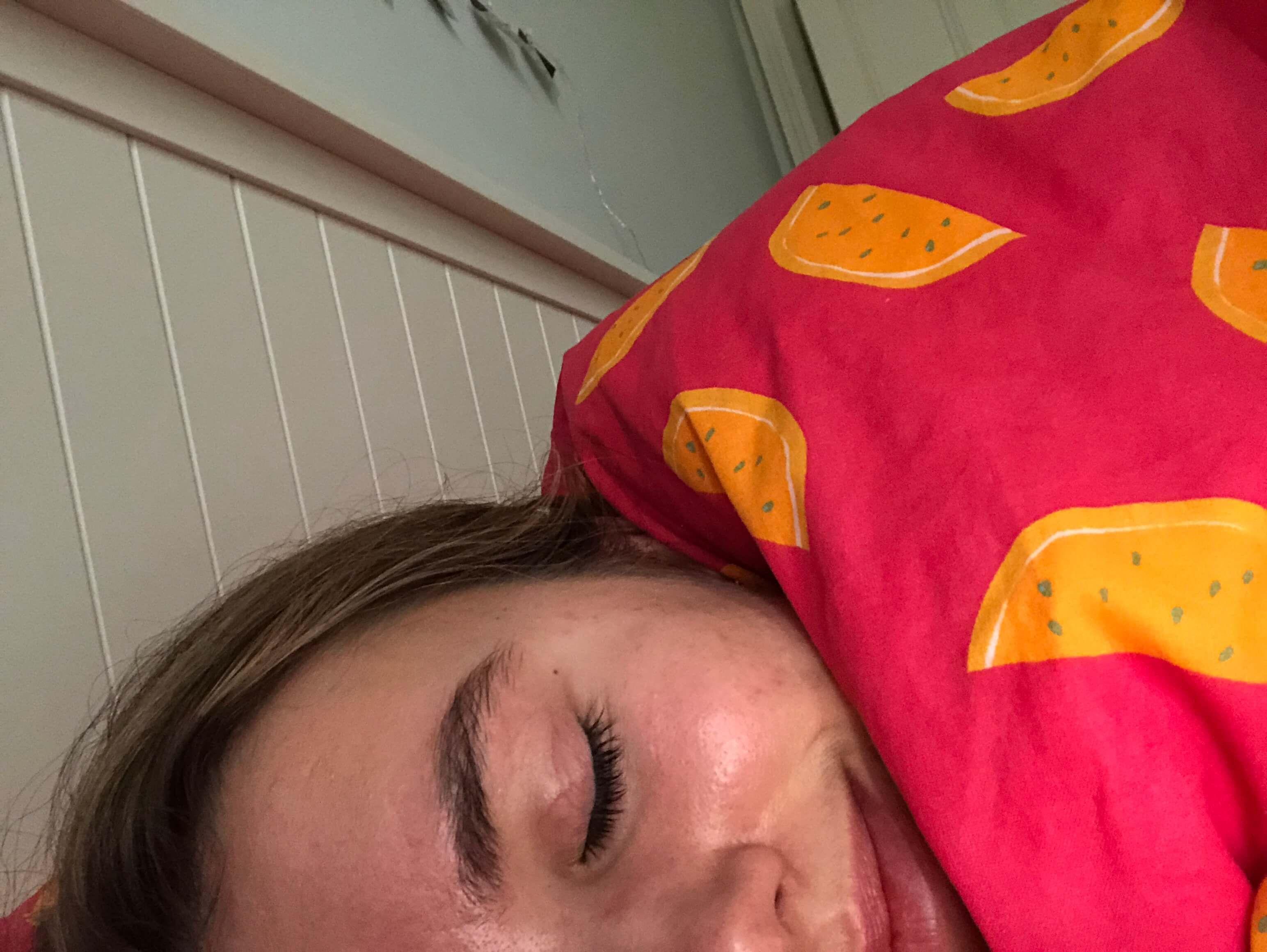 Image may contain: Asleep, Sleeping, Cushion, Head, Face, Human, Person, Clothing, Apparel