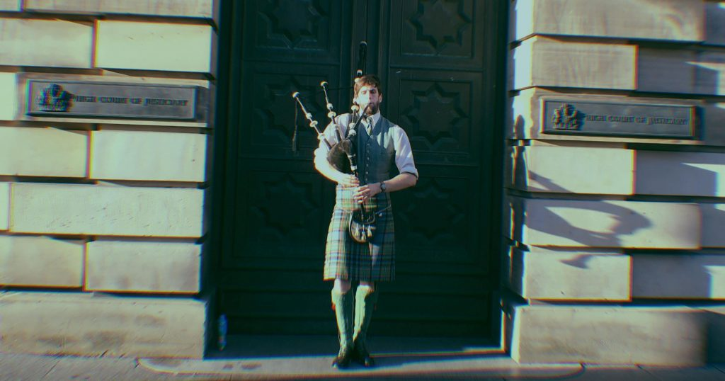 Image may contain: Clothing, Apparel, Bagpipe, Musical Instrument, Guitar, Leisure Activities, Person, Human