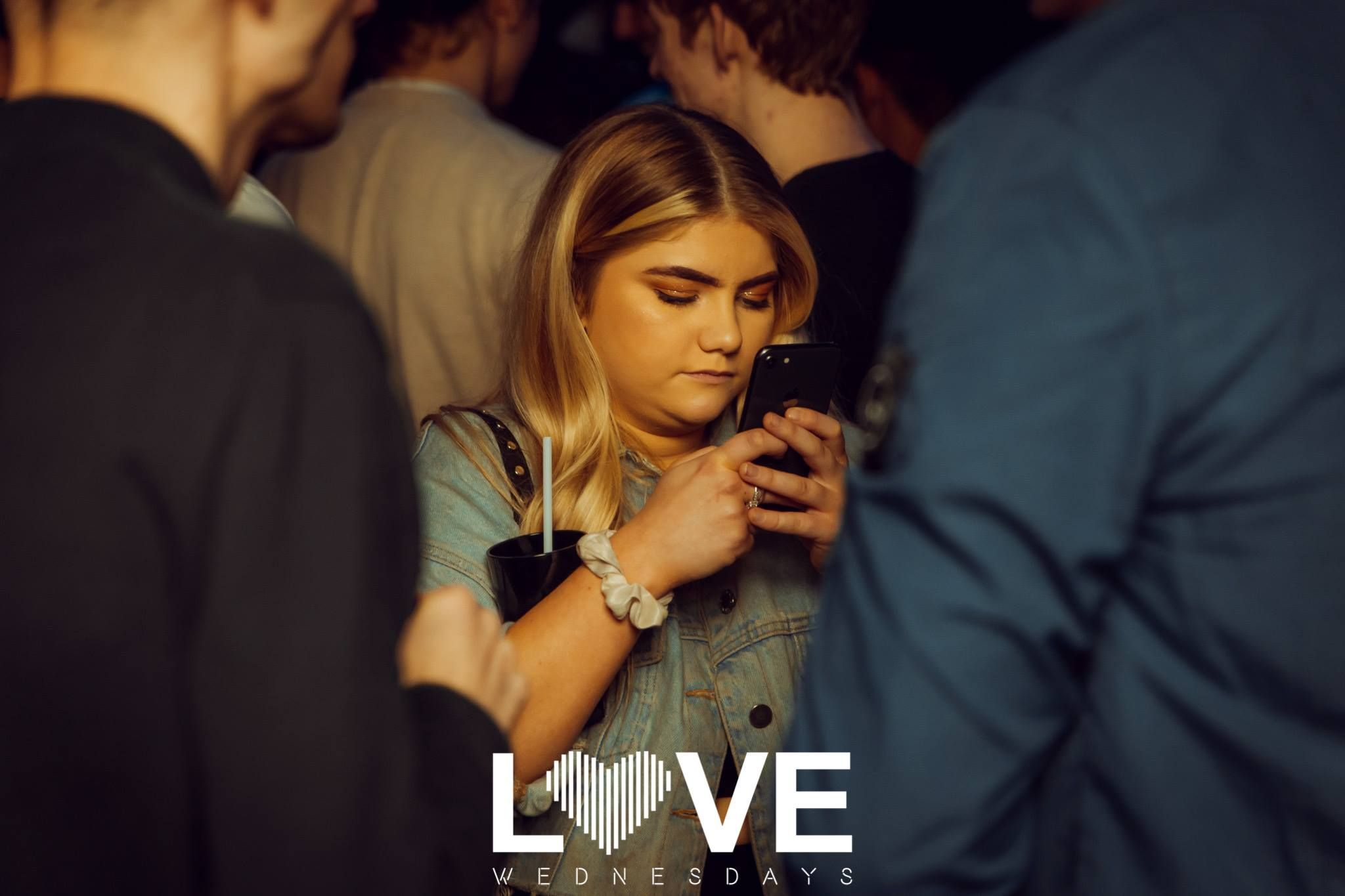 Image may contain: Crowd, Night Club, Club, Pub, Bar Counter, Person, Human