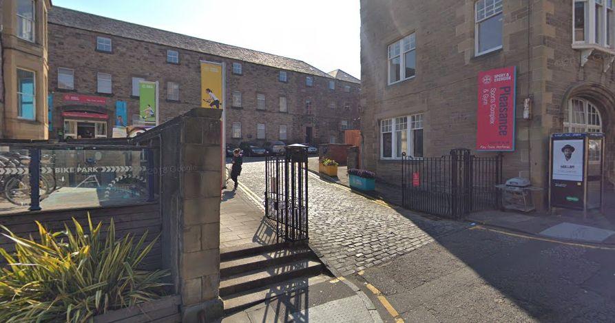 Image may contain: Flagstone, Outdoors, Banister, Handrail, Railing, Pavement, Sidewalk, Human, Person, Path, Walkway