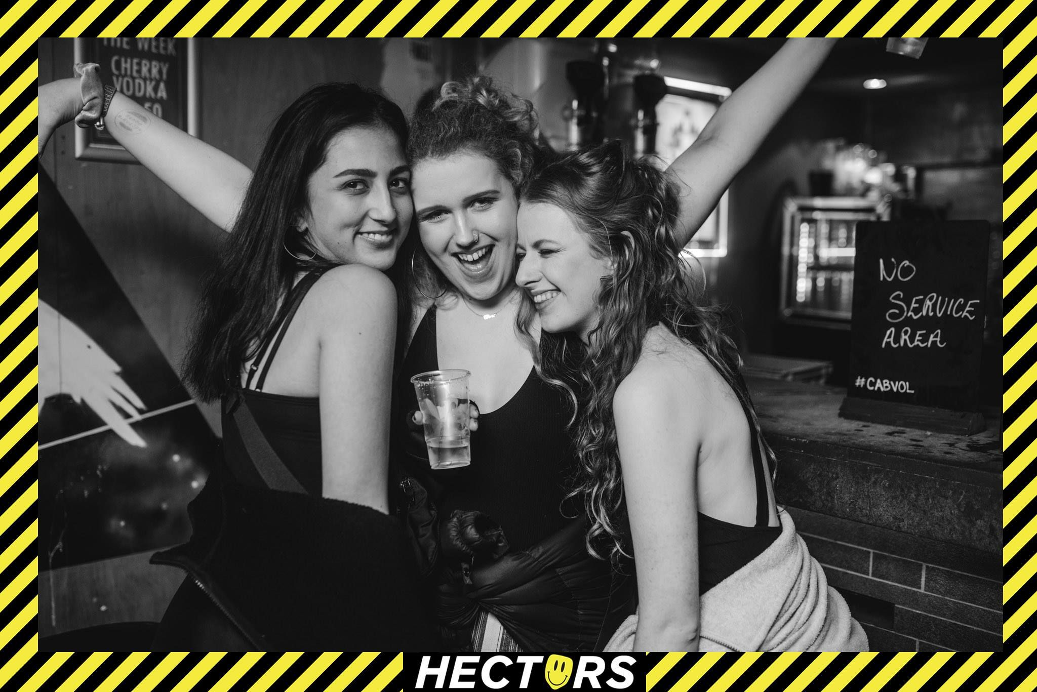 Image may contain: Night Club, Alcohol, Club, Beverage, Drink, Party, Advertisement, Poster, Person, Human
