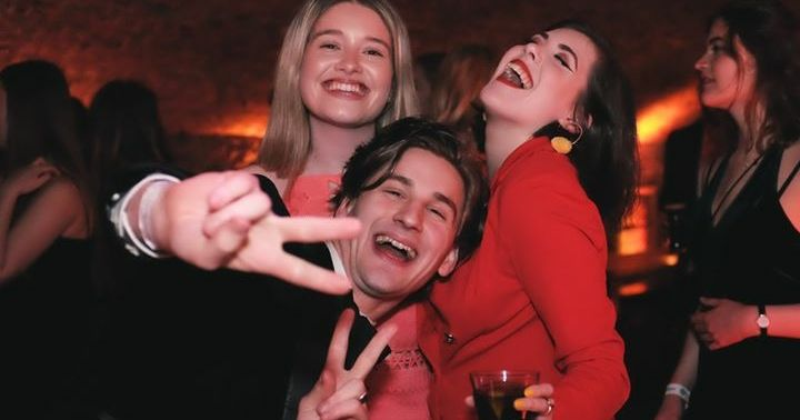 Image may contain: Night Life, People, Woman, Girl, Beverage, Drink, Photography, Portrait, Photo, Clothing, Apparel, Laughing, Night Club, Club, Female, Party, Smile, Face, Person, Human