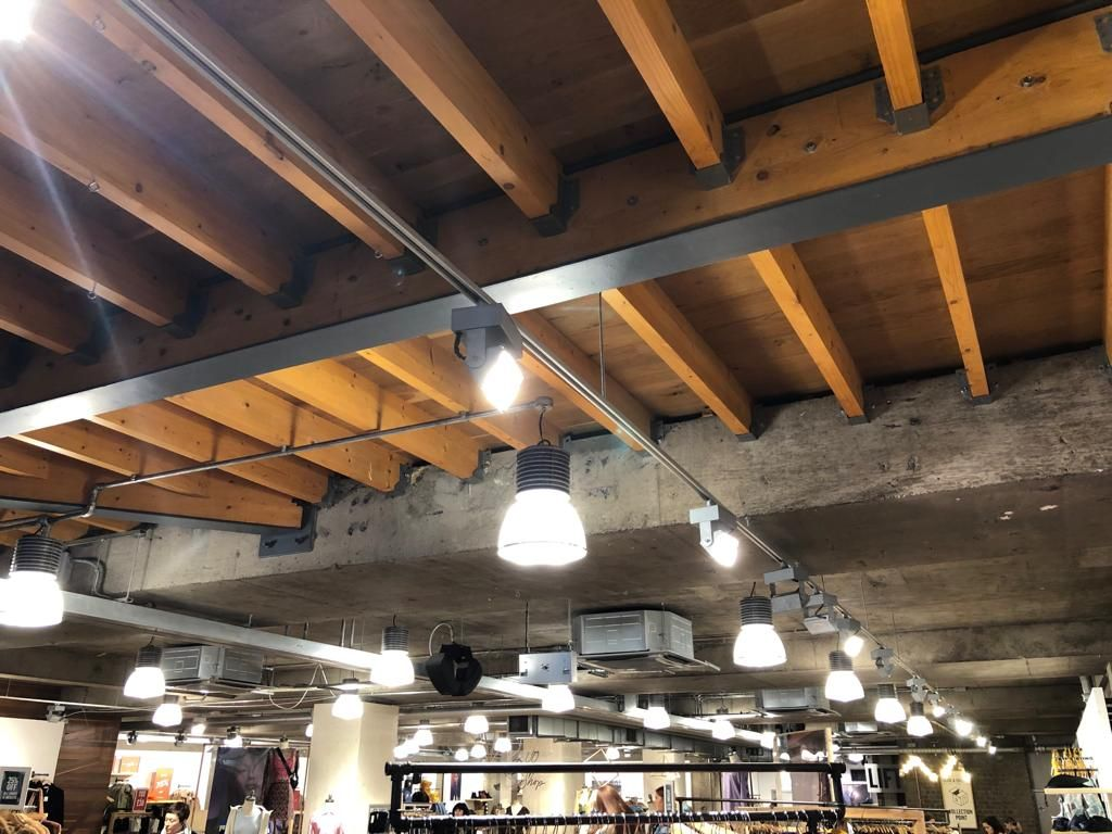 Image may contain: Bookstore, Book, Building, Shop, Aircraft, Airplane, Transportation, Vehicle, Interior Design, Indoors, Person, Human, Wood, Lighting