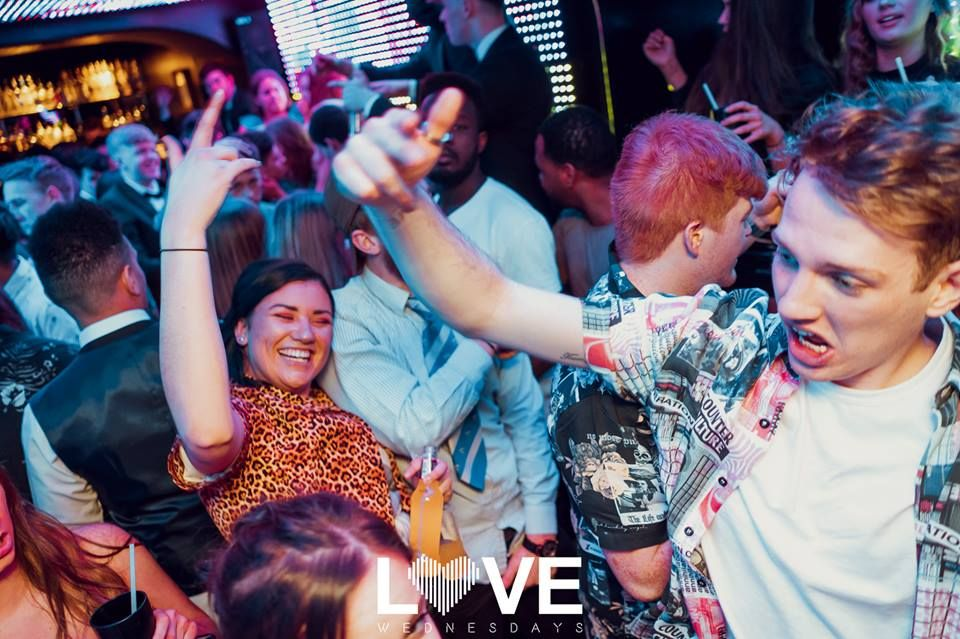Image may contain: Audience, Leisure Activities, Interior Design, Indoors, Night Club, Face, Club, Festival, Crowd, Night Life, Human, Person, Party