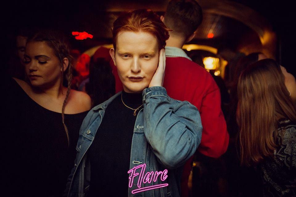 Image may contain: Coat, Jacket, Apparel, Clothing, Bar Counter, Pub, Night Club, Night Life, Club, Person, Human