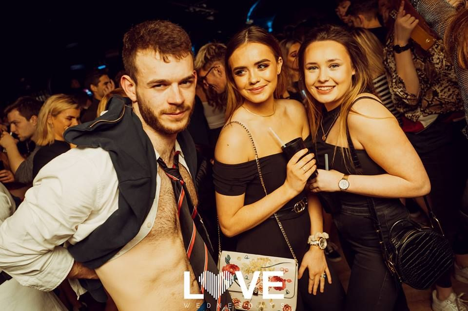 Image may contain: Night Life, Building, Clock Tower, Architecture, Tower, Night Club, Club, Party, Person, Human
