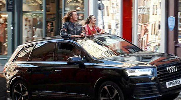 Image may contain: Police Car, Sedan, Transportation, Automobile, Vehicle, Car, Person, Human