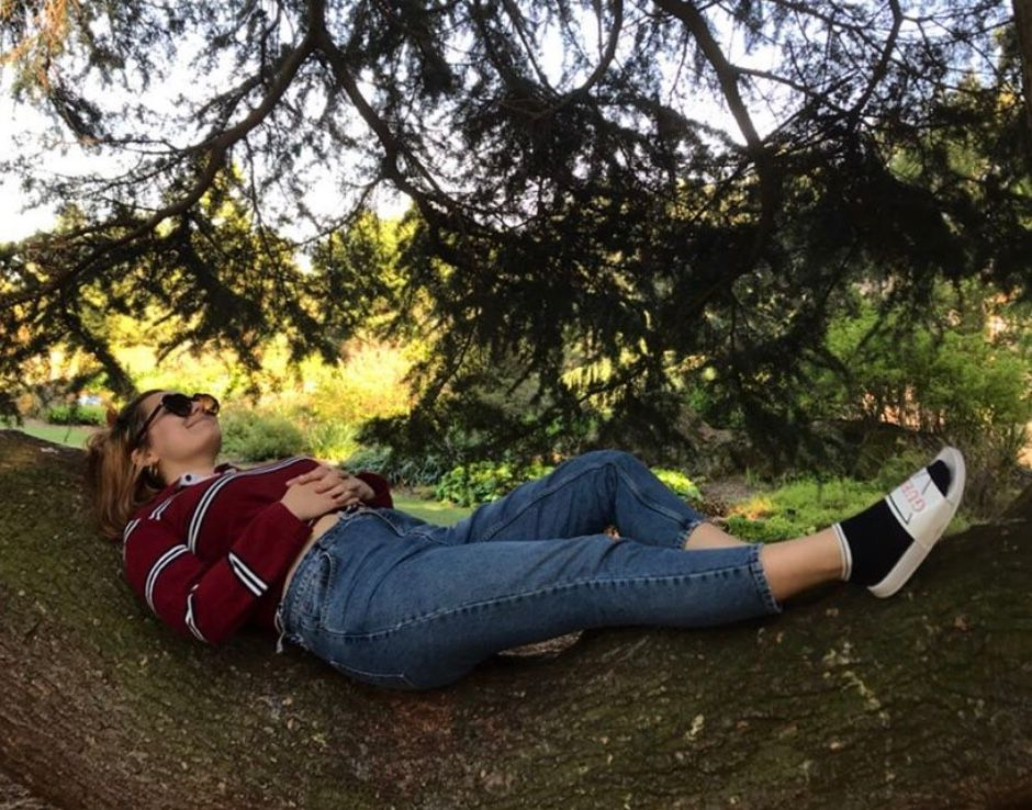 Image may contain: Woman, Forest, Woodland, Land, Nature, Sunglasses, Accessory, Accessories, Shoe, Bush, Footwear, Outdoors, Female, Face, Tree, Grass, Person, Human, Plant, Vegetation, Denim, Jeans, Pants, Clothing, Apparel