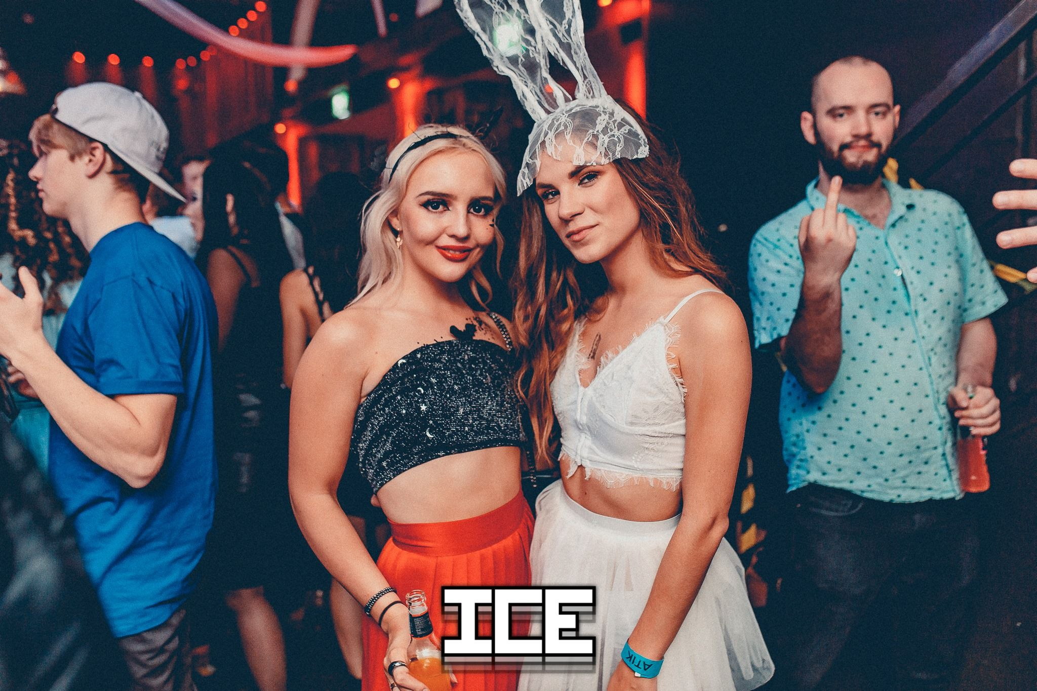 Image may contain: Night Club, Club, Hat, Apparel, Clothing, Person, Human