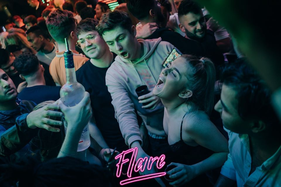 Image may contain: Interior Design, Indoors, Audience, Crowd, Night Club, Club, Party, Human, Person