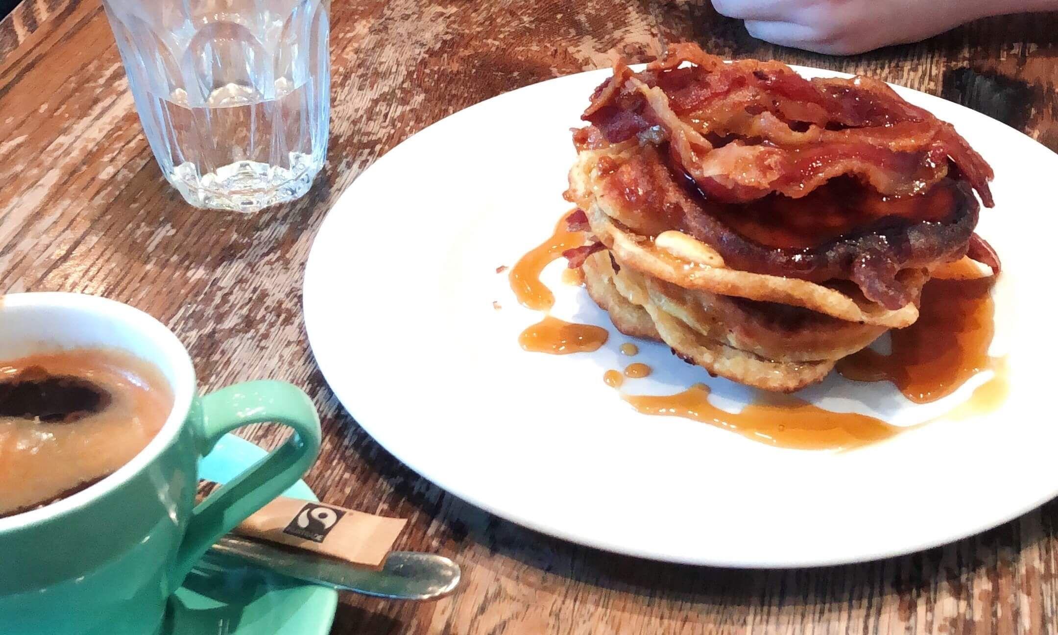 Image may contain: Dish, Person, Human, Meal, Pork, Food, Burger