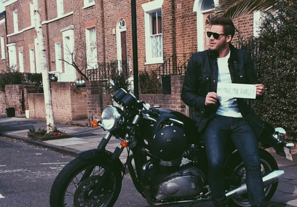 Tom Ackerley pictured on a motorcycle