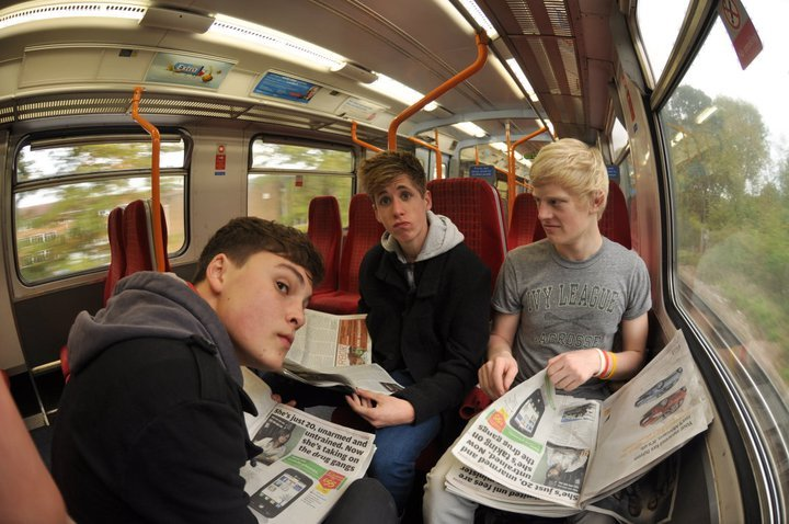 three teenagers on the train from Surrey to London