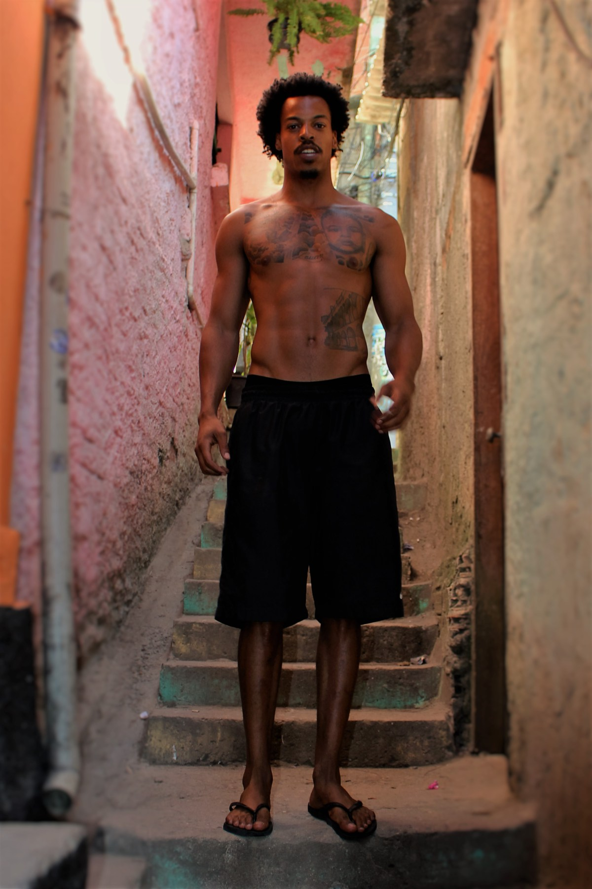 Oberdan standing on a staircase in Vidigal