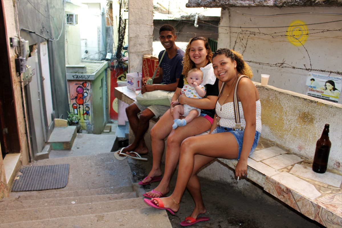Mary and her friends sitting on a staircase in Vidigal