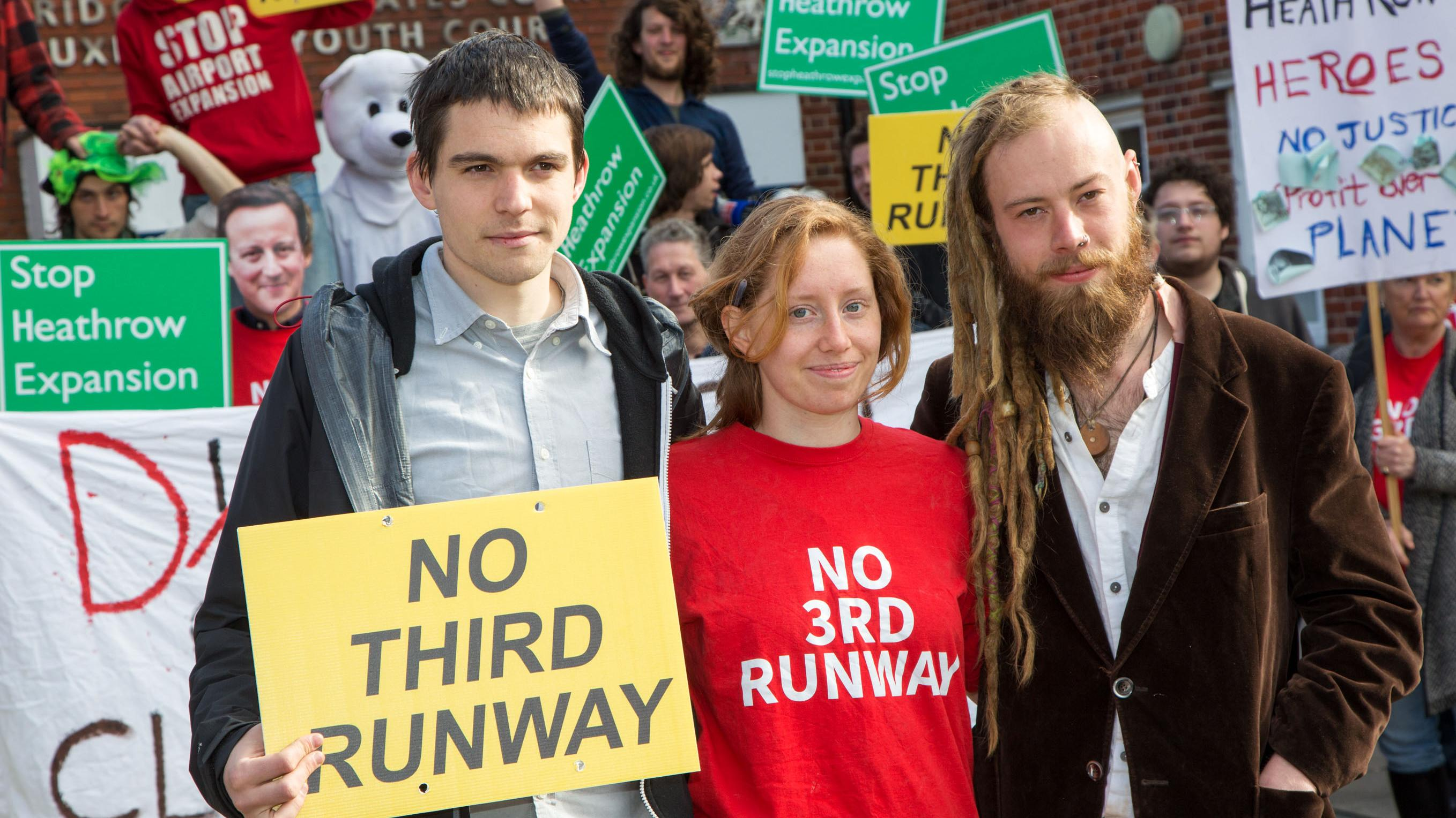 Two of the City Airport activists, Esme Waldron (centre) and William Pettifer (right)
