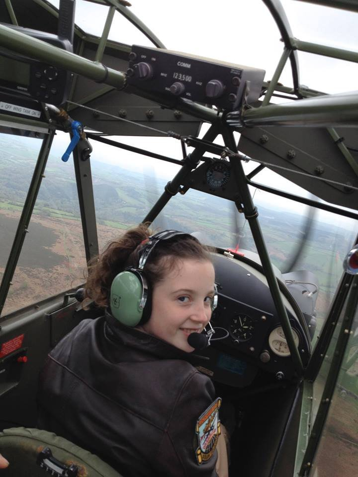 "Ellie Carter during a flying leesson. See SWNS story SWGLIDER; FLYING solo has been the dream of a North Devon schoolgirl since she could talk and this week she did it, becoming the UK's youngest female glider pilot. Ellie Carter, 14, of Torrington has been obsessed with flying for years and hit the headlines a few years ago after writing to the Royal International Air Tattoo, a special aerospace event held every year, to ask if her favourite plane, the U2 spy plane, would be there. Ellie's first solo flight was on Monday, November 28, from North Hill Airfield near Honiton. The youngster, who attends South Molton Community College, is even more determined to achieve her dream job as a test pilot after Monday's flight. She said: ""I loved flying solo. I never get scared, I love being in control and it's important to stay calm while flying, it's safer. ""I've always been obsessed with flying, the science behind it, and if I had been born earlier I think I would have been one of the first female aviators. ""To be honest Monday felt like any other flight to me, it didn't make much of a difference being on my own."" Her plea to see a U2 spy plane in 2012 was picked up by show chiefs at RAF Fairford who gave her the opportunity to sit in a chase car travelling at approximately 120mph as it attempted to keep up with a landing U-2 plane."