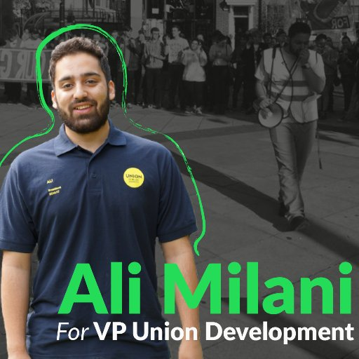 Ali Milani's campaign picture, showing him wearing a high vis and speaking into a megaphone