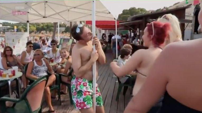 Image may contain: Crowd, Swimwear, Clothing, Bikini, Person, People, Human
