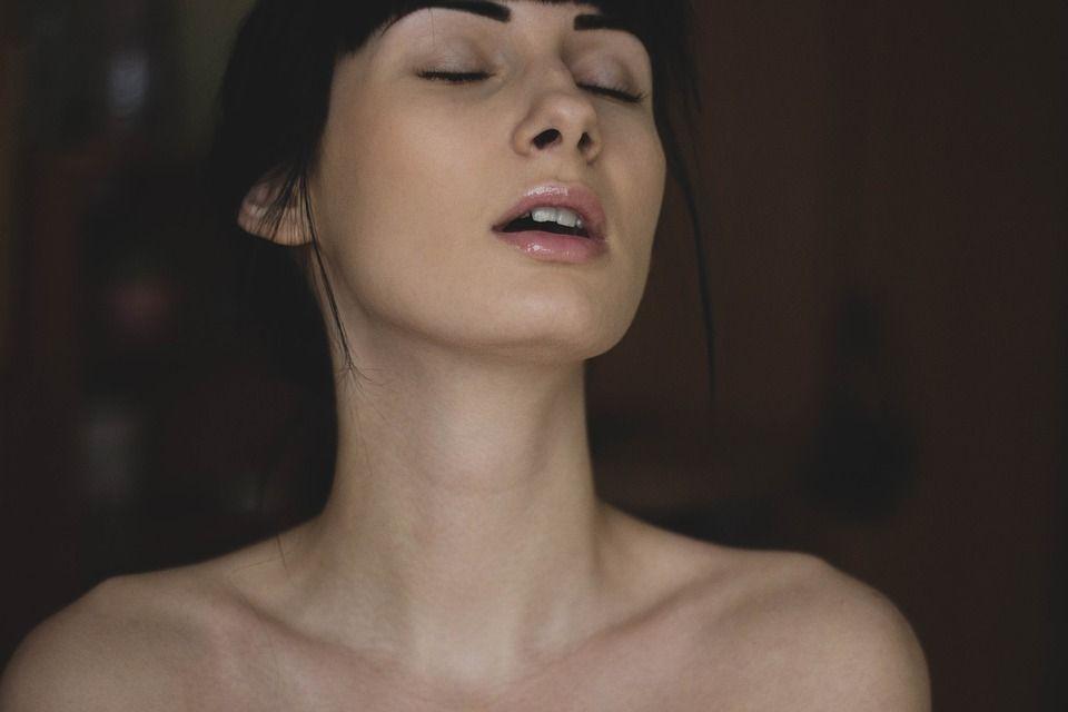 Sexy latina massaging her big busty boobs