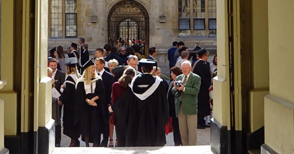 Image may contain: Graduation, Clothing, Apparel, Human, Person