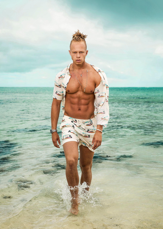 Image may contain: Vacation, Outdoors, Ocean, Water, Nature, Sea, Man, Human, Person, Shorts, Apparel, Clothing, Skin