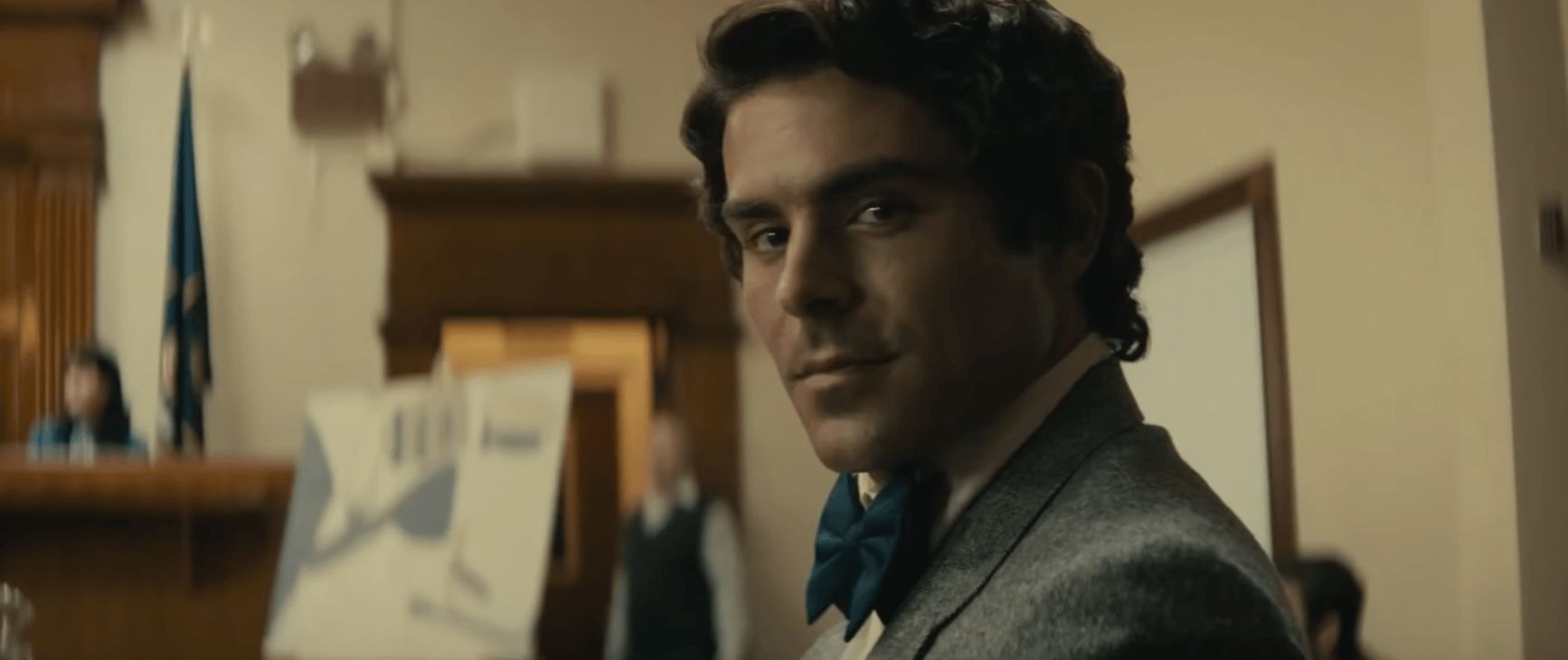 Image may contain: Zac Efron Ted Bundy film, Zac Efron, Ted Bundy, Netflix, True Crime, Apparel, Overcoat, Coat, Clothing, Suit, Man, Face, Human, Person