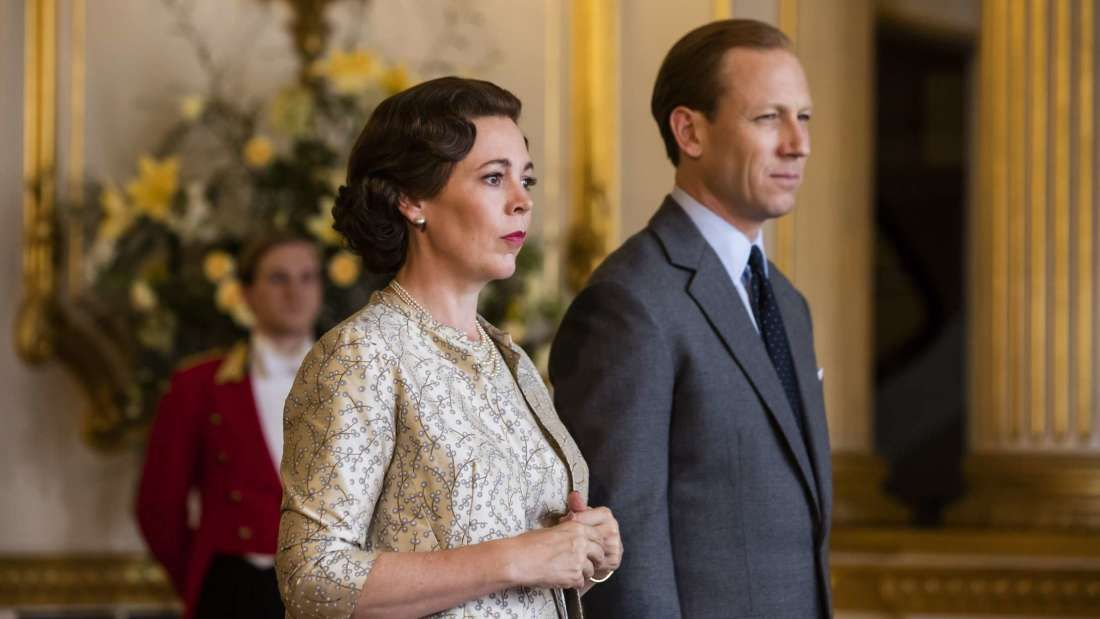 Image may contain: The Crown season 3, The Crown, Netflix, The Queen, Prince Philip, Jacket, Blazer, Accessory, Accessories, Tie, Fashion, Robe, Evening Dress, Gown, Home Decor, Coat, Overcoat, Apparel, Suit, Clothing, Person, Human