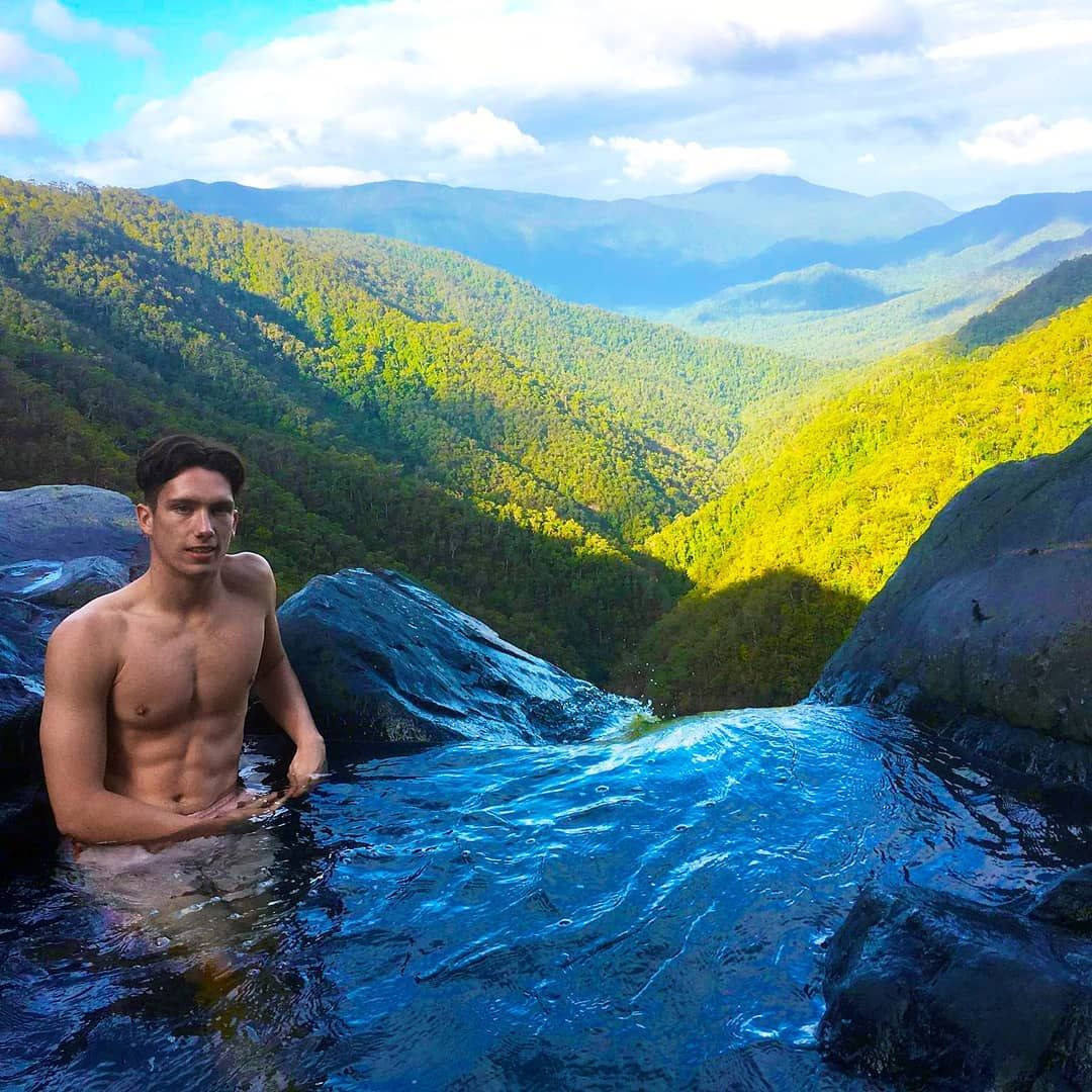 Image may contain: Mountain Range, Scenery, Landscape, Water, Mountain, Outdoors, Nature, Person, Human