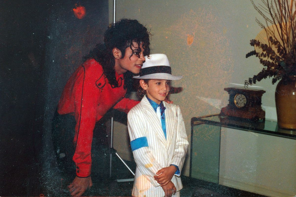Image may contain: Leaving Neverland, Michael Jackson, Wade Robson, James Safechuck, documentary, channel 4, Accessories, Accessory, Tie, Architecture, Tower, Clock Tower, Building, Sun Hat, Hair, Human, Person, Hat, Apparel, Clothing