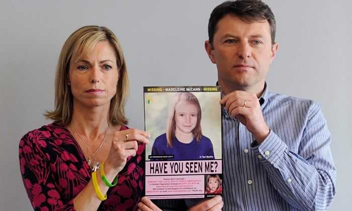 Image may contain: McCann spokesman Clarence Mitchell, Madeleine McCann, Kate and Gerry, Kate McCann, Gerry McCann, Advertisement, Face, Shirt, Clothing, Apparel, Person, Human