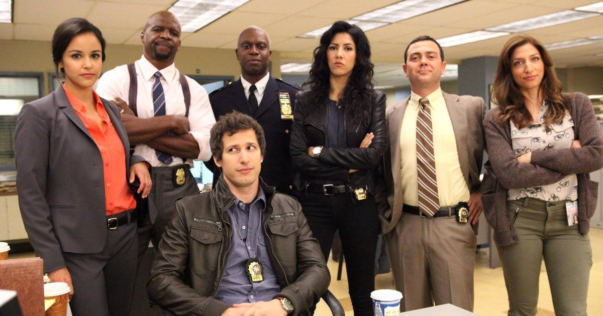 Image may contain: Brooklyn Nine-Nine season 7, Brooklyn Nine-Nine, b99, Brooklyn 99, Brooklyn Nine Nine, cast, release date, Netflix, new series, new season, Crowd, Suit, Overcoat, Coat, Jacket, Person, Human, Accessory, Tie, Accessories, Apparel, Clothing