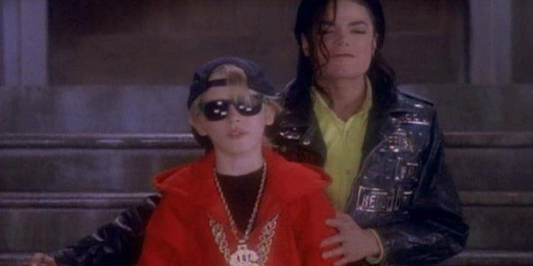 Image may contain: Michael Jackson and Macaulay Culkin, Macaulay Culkin, Michael Jackson, Leaving Neverland, Female, Glasses, Coat, Jacket, People, Face, Sunglasses, Accessory, Accessories, Person, Human, Apparel, Clothing
