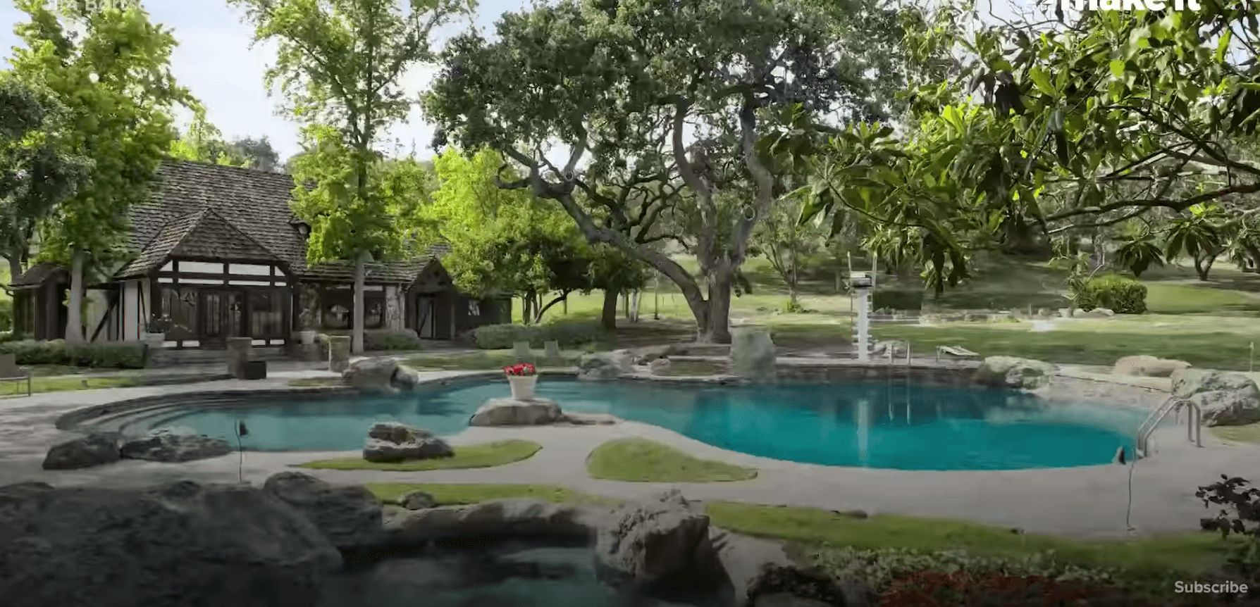 Image may contain: Neverland Ranch, Leaving Neverland, Lawn, Park, Swimming Pool, Forest, Woodland, Grove, Building, Garden, Tree, Grass, Land, Yard, Vegetation, Plant, Nature, Pool, Outdoors, Water