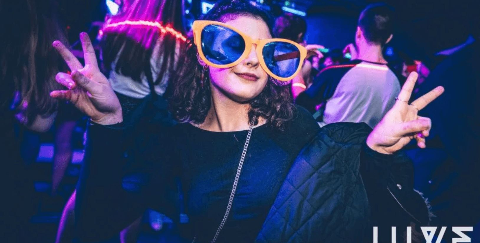 Image may contain: April Fool's Day 2019, fake news, April Fool's, prank, Purple, Crowd, Face, Night Club, Party, Glasses, Club, Night Life, Person, Human, Accessories, Sunglasses, Accessory