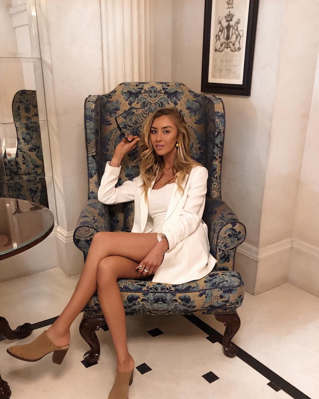 Image may contain: Made in Chelsea cast are actually from, Made in Chelsea, cast, place of birth, from, Habbs, Sophie Habboo, Sitting, Furniture, High Heel, Person, Human, Shoe, Footwear, Clothing, Apparel