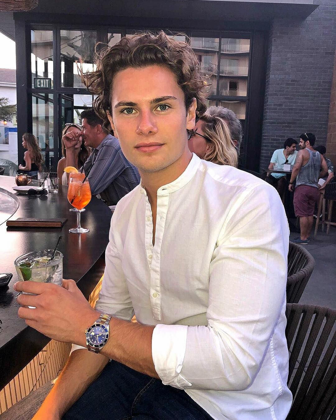Image may contain: Love Island 2019 Instagrams, Joe Garratt, Instagram, Love Island, 2019, contestant, Islander, cast list, line up, Cafe, Food, Food Court, Cocktail, Alcohol, Beverage, Drink, Glass, Bar Counter, Pub, Restaurant, Human, Person